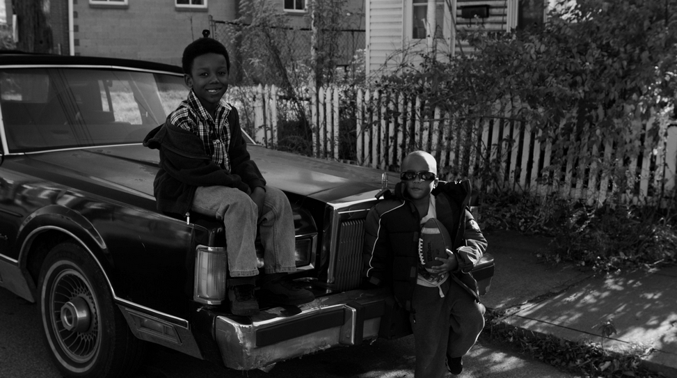Jarrell and friend on car